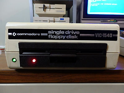 Commodore VIC-1540 Floppy Disk Drive *Tested* w/ power cable some ceramic chips