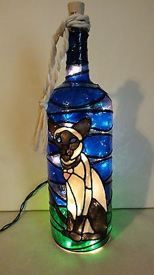 Santa Bottle Lamp Hand Painted Lighted Stained Glass look