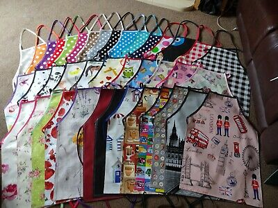 pvc waterproof wipe clean aprons adult and childs 5 sizes spots stars and check