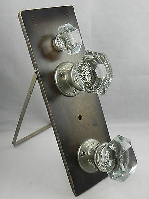 Three Antique Glass Door Knobs On Display Board