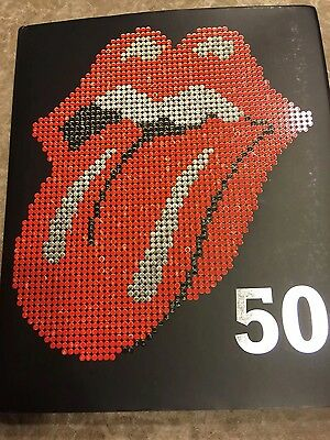 the rolling stones 50 anniversary hard cover collectible book.
