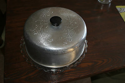 Vintage aluminum embossed cake cover with glass plate. Metal w. flowers