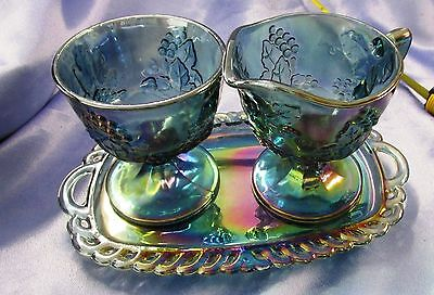 Iridescent Carnival Glass Blue creamer and sugar on its Tray