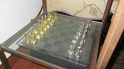 metal chess set with glass board
