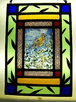Stained glass window hanging with victorian glass