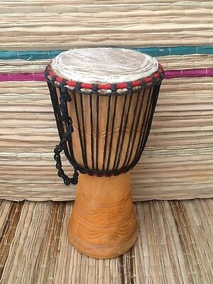 """Genuine African 9"""" Djembe drum with free drum hat."""