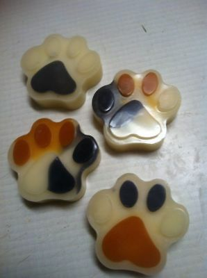 Four large pure beeswax Dalmatian puppy feet shaped scented tart melts