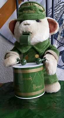 Harrods bear. In a green Harrods cap, green coat whistle & green Harrods drum.