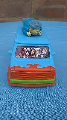 Scooby doo the mystery machine van with man/ghost on top.