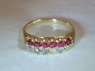 A Victorian 18ct Yellow Gold Dress Ring.Set with Rubies & Rose cut Diamonds