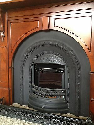 Ornamental cast iron electric fireplace and timber mantle
