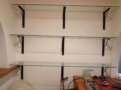 glass shelves with metal brackets