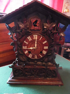 A  Victorian   Carved Cuckoo Clock