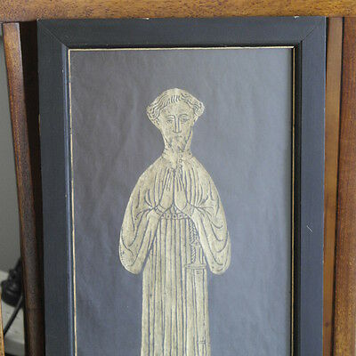 Antique rubbing of medieval man with sword.