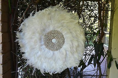 Juju hat. Round White feather & Cowrie Shell wall feature art.