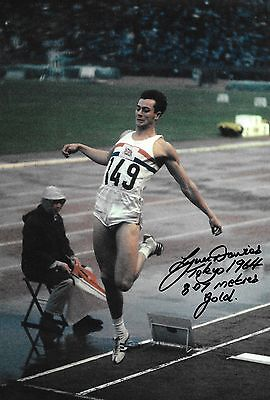 lynn davies making a jump in the final tokyo 1964 signed 12x8 photo