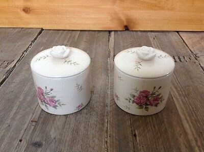 a pair of small matching pots