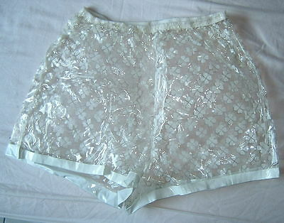 PVC VINTAGE  60's SHORT GLASCLEAR  WITH WHITE FLOWERS MEDIUM WAIST 39 INCH