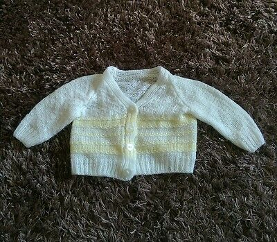 Unisex hand knitted baby cardigan white and yellow. 9-12 months