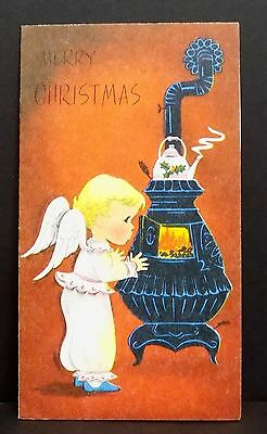Vintage Christmas Card Greeting Angel Warming Up By Pot Belly Stove Tea Pot
