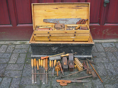 old wooden tool box with wood working tools