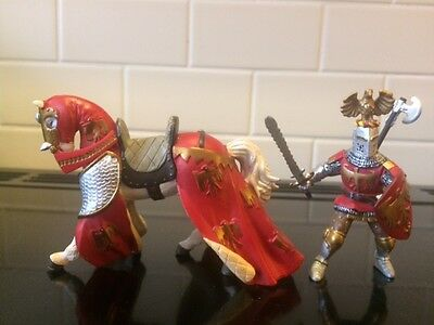 Schleich red and gold knight and horse figure