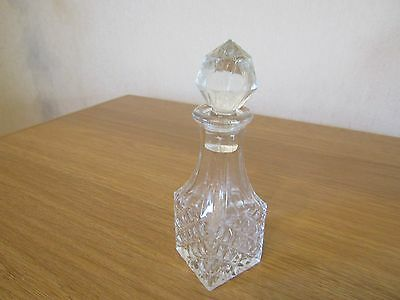 Pretty patterned glass perfume etc. bottle with stopper.