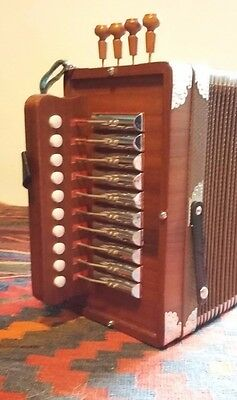 Melodeon cajun one row four stop in C
