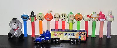 Pez collection including truck. hello kitty and halloween