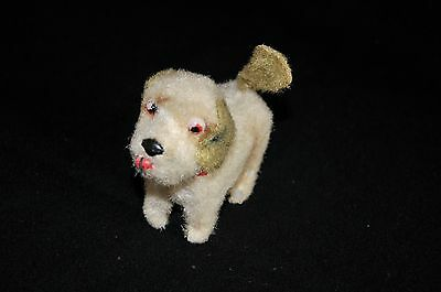 Vintage wind up clockwork dog with spinning tail