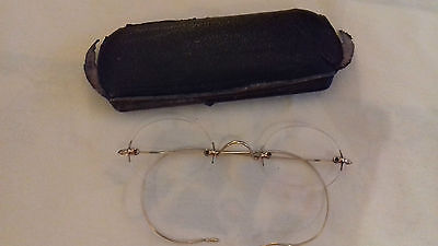 Antique rimless spectacles with yellow metal ear and nose details