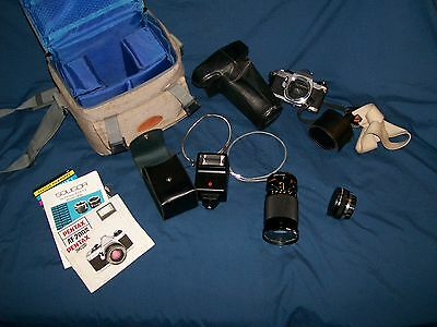 Pentax MG 35 mm camera, zoom lens, 2x converter, case, bag, flash, manuals
