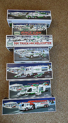 Hess Toy Trucks Lot of 7 New Original Boxes 2000 2001 2003 2004 2006 2009 2010