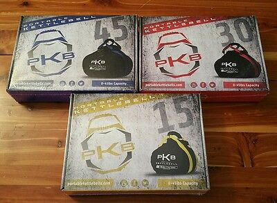 The Portable Kettlebell FULL SET OF THREE 15, 30, 45 Lbs, Red, Yellow, Blue NEW!