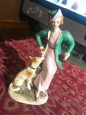Elegant Figurine of a Young Lady in a Pink Dress with a green jacket and dog