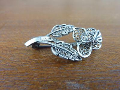 Sterling silver brooch of a rose with filigree