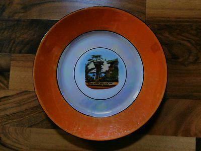 old vintage Wisconsin Dells souvenir plate stand rock man jumping iridescent