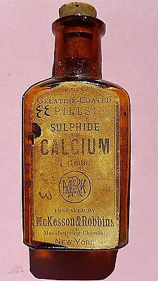 ANTIQUE EMBOSSED MC KESSON & ROBBINS BOTTLE of SULPHIDE OF CALCIUM