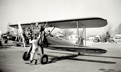 1930s photo Negative Airplane Bi Plane Exposed Cockpit MECHANIC works on Exhaust
