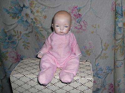 Unmarked Reproduction Bisque Doll Baby in Pink Pajamas
