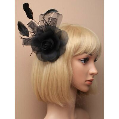 Black fascinator on beak clip. Rose design with net ribbons and feather tendrils