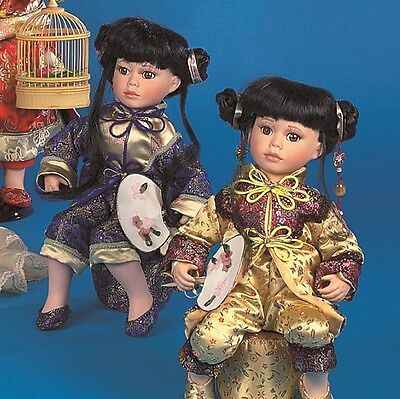 "A Job Lot of 9 Vanity Fair Sitting 16"" Chinese Dolls (3 assorted colours)"