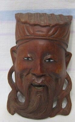 Vintage Chinese mask with glass eyes and bone teeth.