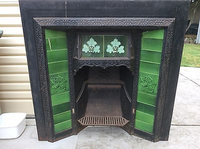 Period Cast Iron Fireplace with Antique Tiles.