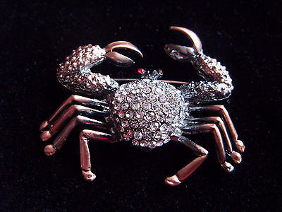 Lovely copper tone and diamante crab brooch with red glass eyes
