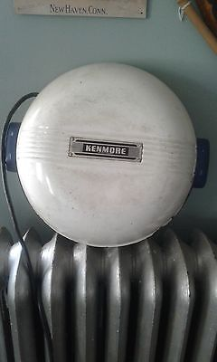 Top off a vintage Kenmore Portable Washing Machine