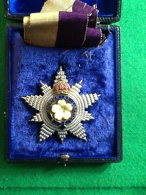 A cased Primrose League Star and ribbon