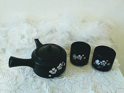 Black Chinese teapot set with 2 cups with floral pattern, leaf infusion teapot