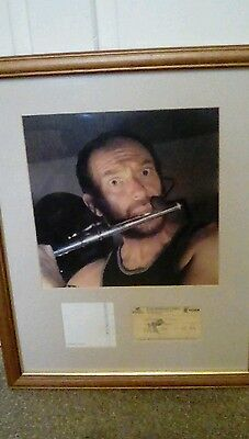 Framed photo of Ian Anderson from Jethro Tull , ticket from 1996 and autograph.