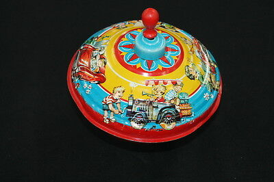vintage 1950s red yellow & blue child's metal spinning top wooden knob